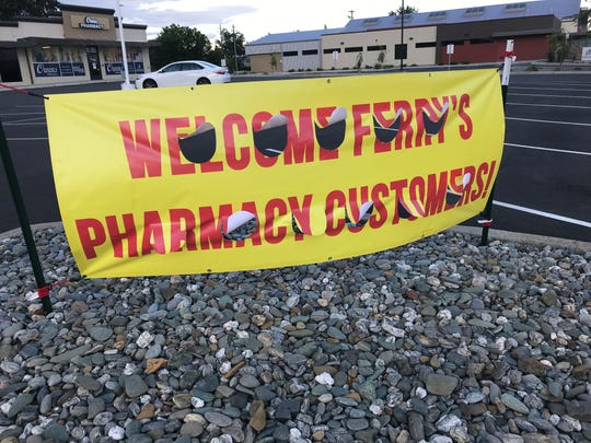 A sign at the corner of North and East streets in Anderson welcomes Ferry's Pharmacy customers to Owens.