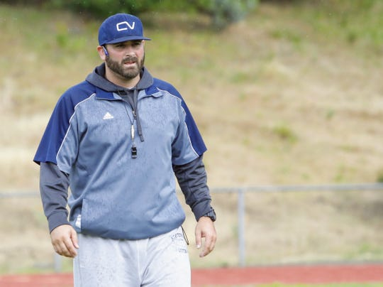 Aaron Richards leads Central Valley's varsity football team through its first spring practice on Monday, May 20.