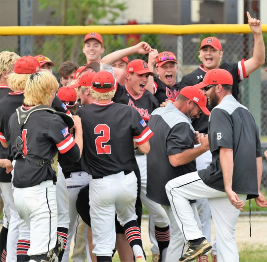 The James M. Bennett baseball team celebrates after defeating Governor Thomas Johnson High School in the 3A state semifinals on Tuesday, May 21, 2019.