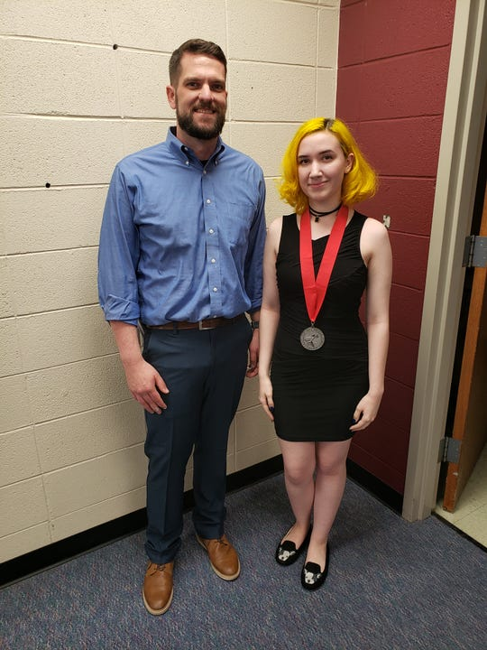 Savannah and her art teacher Josh Loppnow were recognized at a school board meeting on Monday, May 20, 2019.
