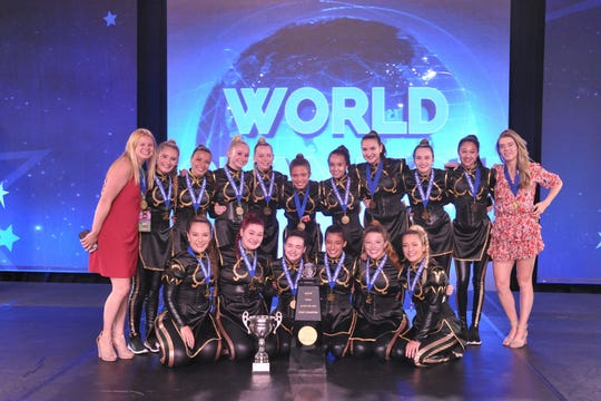 Dollhouse Dance Factory dancers with their Open Elite Hip Hop Gold Championship trophy alongside coaches Kayla Pittner and Betsy Klauck.