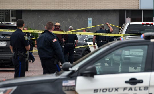 Law enforcement enters the scene after reports of shots fired outside the Minnehaha County Jail on Tuesday, May 21, in Sioux Falls.