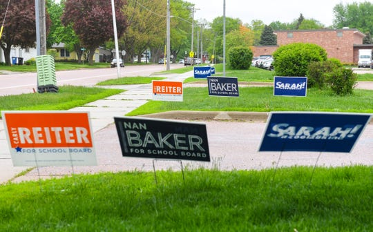 Signs endorsing various school board candidates line the driveway to the Instructional Planning Center, a voting precinct, on Tuesday, May 21, in Sioux Falls.