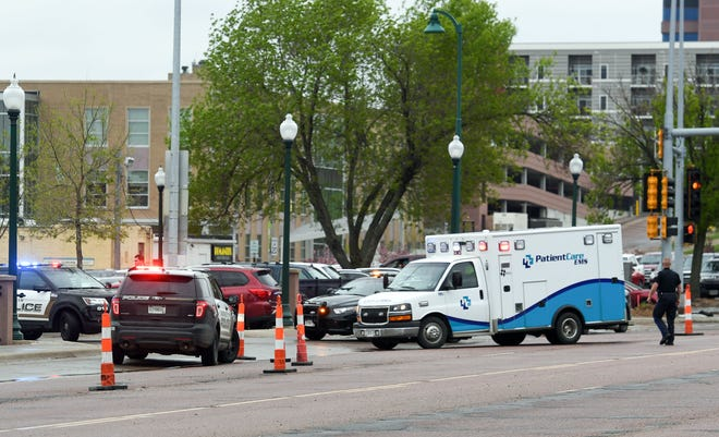 An ambulance arrives on scene after a man was shot by law enforcement outside the Minnehaha County Jail on Tuesday, May 21, in Sioux Falls.