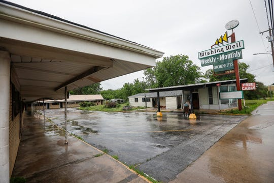 A homeless camp in the woods behind the Wishing Well Motel will be cleared out.