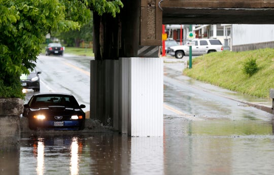 A car drives through water covering Grant Avenue on Tuesday, May 21, 2019.