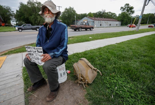 James Smith, panhandles near the Kum & Go on Chestnut Expressway near West Bypass on Monday, May 20, 2019. Smith lives in the homeless camp behind the Wishing Well Motel.