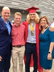 Mark Miller, far left, with sons Ethan and Luke and wife Kelly at Luke's graduation from Glendale High School.