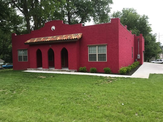 For a dozen years or more, it was a vacant lot.  Then last summer this red house was built.