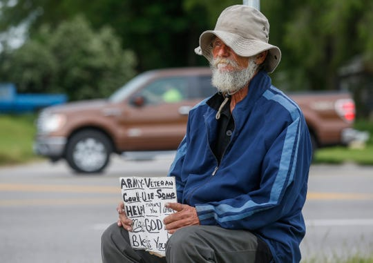 A homeless man panhandles near the Kum & Go on Chestnut Expressway near West Bypass on May 20, 2019. CPO's Alliance to End Homelessness is hosting at event Thursday aimed at dispelling myths about homelessness.