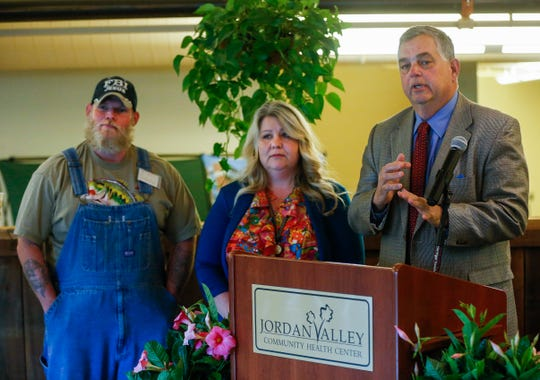 Brooks Miller, the president and CEO of Jordan Valley Community Health Center, right, is joined by Tina Shannon and Quinton Forester as he speaks during a press conference announcing a $1 million grant from UnitedHealthcare on Tuesday, May 21, 2019.