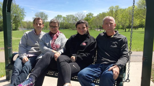 St. Cloud Mayor Dave Kleis meets with the family of Alex Voigt, a German exchange student who died five years ago in a plane crash in Sauk Rapids, at a memorial bench along the Mississippi River on Monday, May 20. Pictured are, from left, Yorck Jetter, Jutta Voigt, Kira Voigt and Kleis.