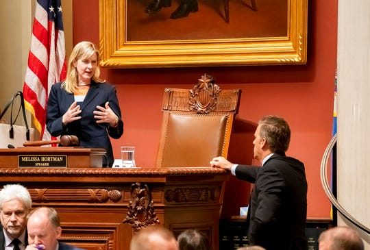 House Speaker Melissa Hortman talks with Republican House Minority Leader Kurt Daudt on the House floor Monday, May 20, at the Capitol in St. Paul.