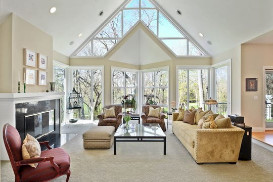The home is flooded with light as the wall opposite the entry is not only vaulted but features a full bank of floor-to-ceiling, wall-to-wall windows.