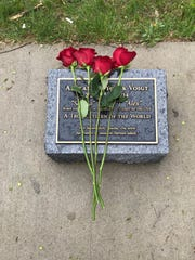 Roses rest upon the a memorial dedicated to Alex Voigt, a German exchange student who died in June 2014 in a plane crash in Sauk Rapids. Voigt's family placed the flowers at the marker Sunday, May 19.