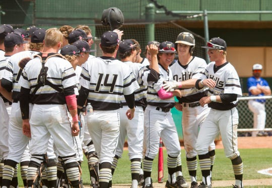 Lance Kinross (14) celebrates with his team during Desert Hills' 16-3 rout of Dixie in the 4A state championship game.