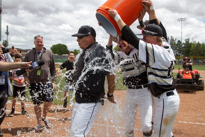 Chris Allred gets dunked with a Gatorade bath after winning the 4A state baseball championship last May.