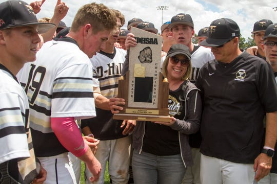 Becky Allred, wife of coach Allred, celebrates with Desert Hills baseball after their 16-3 victory over Dixie for the Utah 4A state title Tuesday, May 21, 2019.