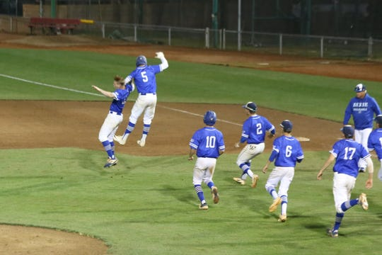 Dixie baseball celebrates after walking off Salem Hills Monday to advance to the state title game.