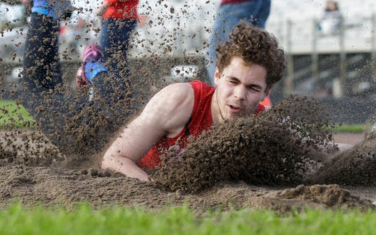 Shawano's Parker Pues competes in the long jump at a Division 1 regional track meet on May 20, 2019, at Lincoln High School in Wisconsin Rapids. Photographer Tork Mason earned a first-place award for sports photo for the image in the Wisconsin Newspaper Association's 2019 Better Newspaper Contest.