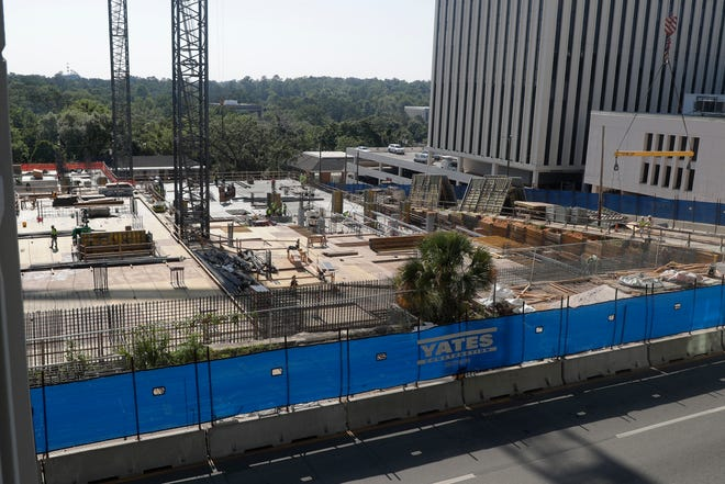 Construction crews continue working to build the Washington Square complex in downtown Tallahassee on the northeast corner of Calhoun Street behind the Leon County Courthouse Tuesday, May 21, 2019.
