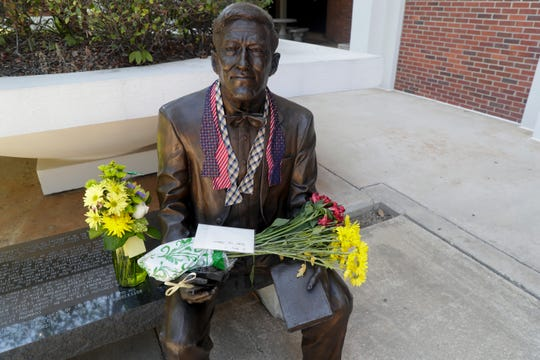 Flowers, bowties and a note are placed on the statue of Sandy D'Alemberte, former Florida State University president and dean of its College of Law, the day after his sudden death, Tuesday, May 21, 2019.