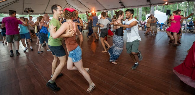 The Family Contra Dance on the Heritage Stage with music by Jackson Creek and the call by Andy Kane, during the 2017 Florida Folk Festival at Stephen Foster State Park in White Springs.