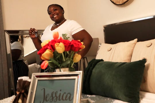 Jessica Williams poses for a photo in her bedroom while holding the keys to her new home from Habitat for Humanity Tuesday, May 21, 2019.