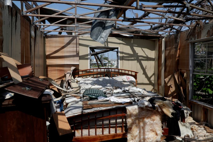 Debris fills a bedroom in Mexico Beach seven months after Hurricane Michael tore the roof off Oct. 10, 2018