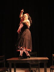 "Carmen (Tiffany Collazo) sings and dances in Lillas Pastia's bar in ""La tragédie de Carmen."""
