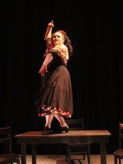 """Carmen (Tiffany Collazo) sings and dances in Lillas Pastia's bar in """"La tragédie de Carmen."""""""