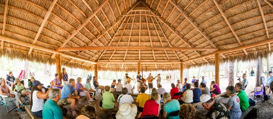 Jam N Jelly plays at the Seminole Camp during the Florida Folk Festival at Stephen Foster State Park in this image comprised of multiple photos taken at the same moment and stitched together to create a panorama.