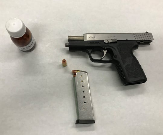 This gun, ammo and generic Xanax were found in an traffic stop that led to two arrests, police said.