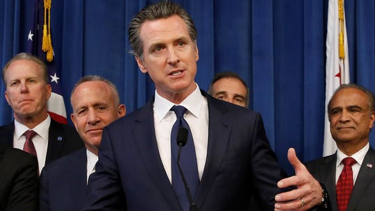 In this Monday photo, Gov. Gavin Newsom, center, discusses the homeless problem facing California after a meeting with the mayors of some of the state's largest cities held at the Governor's office in Sacramento. Newsom is creating a task force on homelessness as the state grapples with a housing crisis.