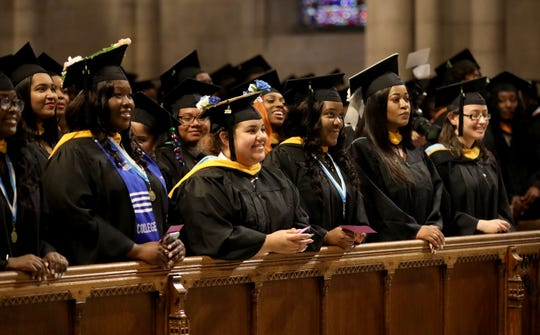 Graduates smile as The College of New Rochelle held their 112th and final commencement at the Riverside Church in New York, May 21, 2019.