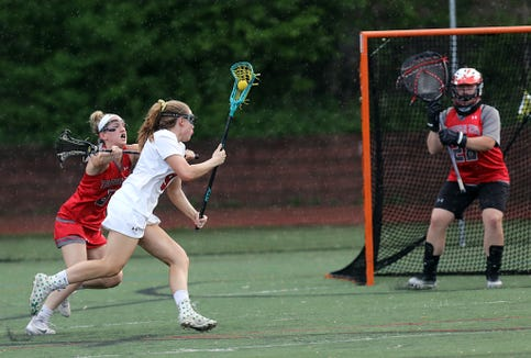 Rye's Catherine Egan (9) scores over Tappan Zee's Katheryn Staker (5) and goalie Liz Tompkins (28) during girls lacrosse game at Rye High School on May 20, 2019. Rye defeats Tappan Zee 10-9.