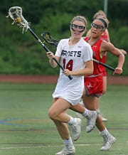 Tappan Zee's Marley Wright (16) guards Rye's Grace Wyckoff (14) during girls lacrosse game at Rye High School on May 20, 2019. Rye defeats Tappan Zee 10-9.