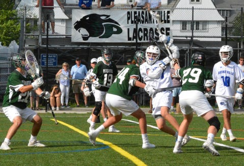 Bronxville's Teddy Donohue (7) plows through a pair of Pleasantville defenders in the first half of an 11-10 overtime loss to the Panthers on May 20, 2019.