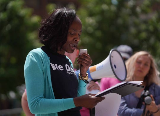 Shané Darby, with Network Delaware's Reproductive Justice Campaign, speaks to supporters at rally in Rodney Square Tuesday protesting a new wave of bans on abortion and attempts to gut Roe v. Wade.