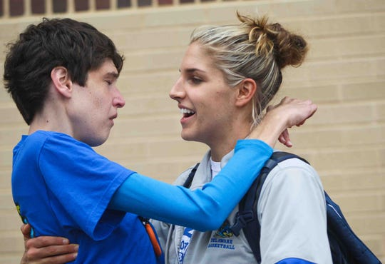 Elena Delle Donne gives her sister, Lizzie, a kiss and hug as the University of Delaware women's basketball team returns to the Bob Carpenter Center after their season ended in 2012 in the NCAA tournament.