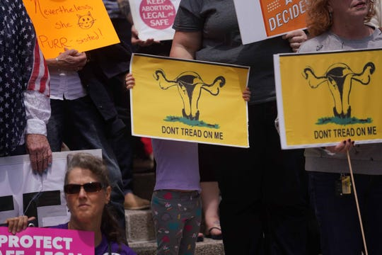 Supporters of #stopthebans rally in Rodney Square Tuesday afternoon at protest hosted by the ACLU of Delaware. They were protesting a new wave of extreme bans on abortion and attempts to gut Roe v. Wade.