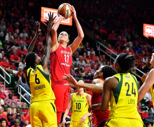 Washington Mystics forward Elena Delle Donne (11) shoots as Seattle Storm forward Natasha Howard (6) defends during the second half in game three of the WNBA Finals at Eagle Bank Arena.