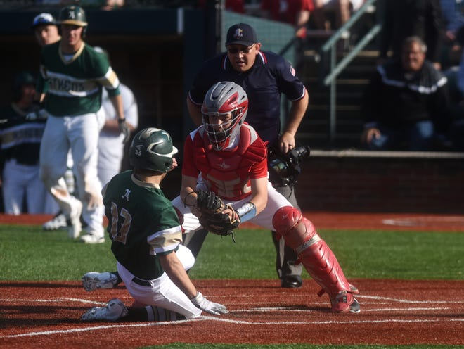 Sheridan's Jesse Gillenwater tags out Athens' Jack Cornwell at the plate during the Generals' 8-1 loss in a Division II district semifinal at Bob Wren Stadium.