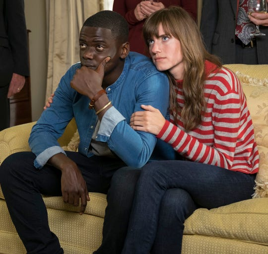 """Chris (Daniel Kaluuya, left) gets more than he bargained for when he meets his girlfriend's (Allison Williams) family in the racially charged horror film """"Get Out."""""""