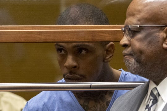 Eric Ronald Holder Jr., 29, who is accused of killing of rapper Nipsey Hussle, appeared for arraignment in Los Angeles with attorney Christopher Darden on April 4, 2019. Darden has since withdrawn from the case, citing death threats.
