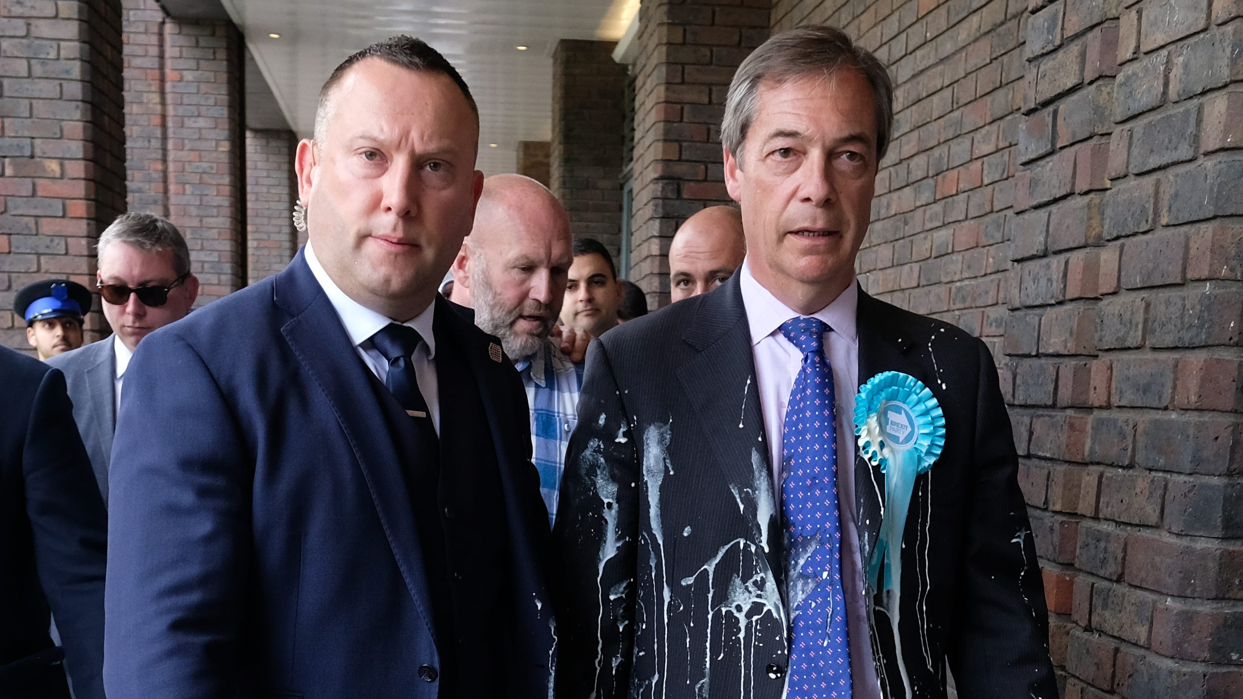 Brexit Party leader Nigel Farage, right, has what is thought to have been a milkshake thrown over him during a whistle stop tour on May 20, 2019 in Newcastle Upon Tyne, England.
