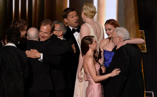 "George R.R. Martin, celebrates with the ""Game of Thrones"" cast after the show won the best drama-series Emmy in 2015."