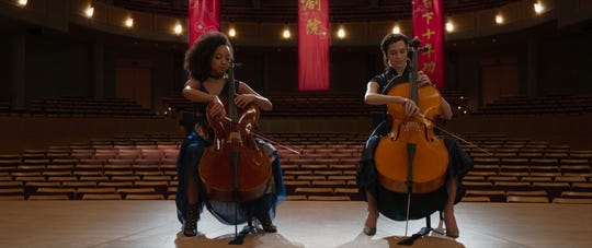 Lizzie (Logan Browning, left) and Charlotte (Allison Williams) are two cello prodigies who trained at the same academy.