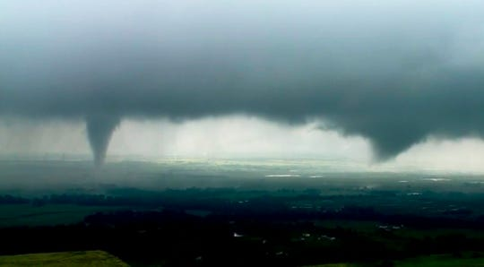 This image made from video provided by KWTV-KOTV shows two funnel clouds formed in Crescent, Okla., Monday, May 20, 2019.