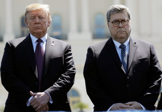 President Donald Trump and Attorney General William Barr attend the 38th Annual National Peace Officers' Memorial Service at the U.S. Capitol, May 15, 2019, in Washington.